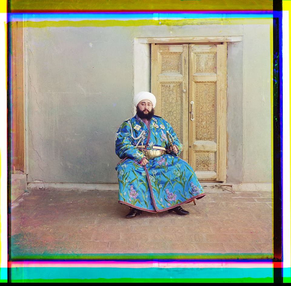 Alim Khan, Emir of Bukhara, seated holding sword